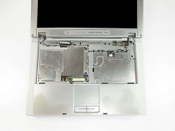There are four wires running from the display through small channels in the body of the 700m.