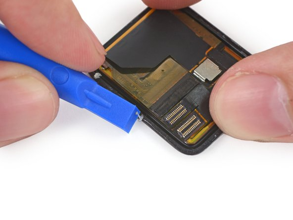 Use a plastic opening tool to scrape adhesive off the back of the screen.