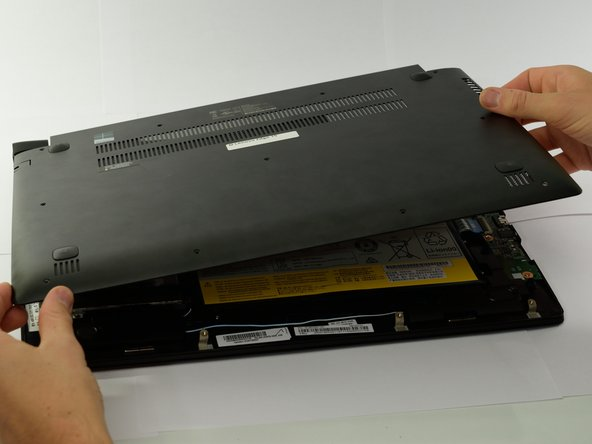 Gently lift the cover plate off the body of the laptop, ensuring that it does not pull on any components such as the USB ports.