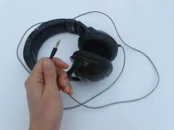 Gently gripping the auxiliary cable of your headset, run your fingers down it's length, feeling for bumps or tears in the plastic sheathing. If there are multiple damaged areas, choose the one closest to the device.