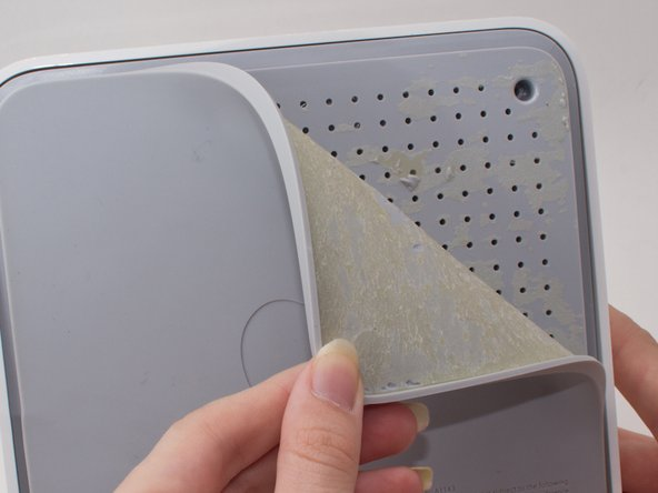 First start by peeling off the outer rubbery covering on the bottom of the device.