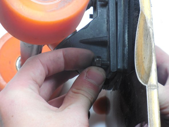 Use your fingers to fully loosen and remove the nuts from the bolts.