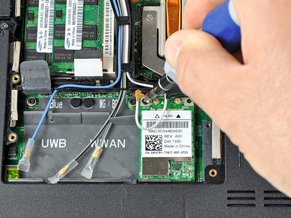 Remove the 3.70 mm Phillips #1 screw securing the card to the laptop.