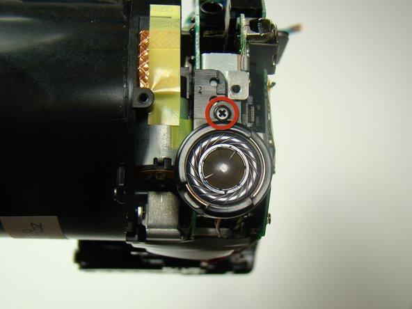 Remove the screw above the speaker