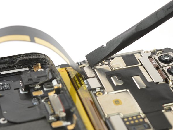 Use a spudger to pry up and disconnect the charging port and headphone jack flex cable.