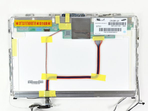 Turn the LCD panel assembly over so that the screen is face down. You may want to use a cloth on your worksurface to prevent scratching the screen.