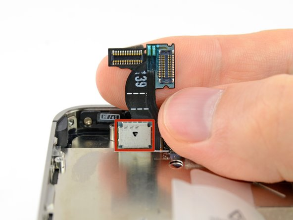 During reassembly, do not touch the metallic area at the base of the LCD data cable, as this can cause problems with the LCD. If you do touch it accidentally, clean it gently with an alcohol wipe before continuing.