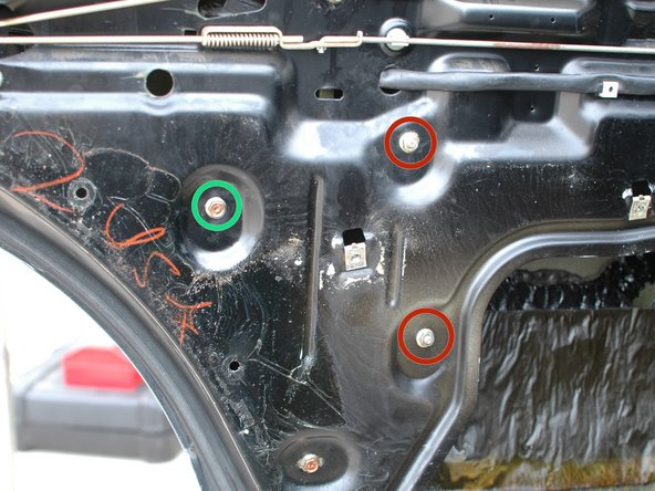 Loosen and remove the two 10mm nuts that hold the regulator's pegs in to the door shell.