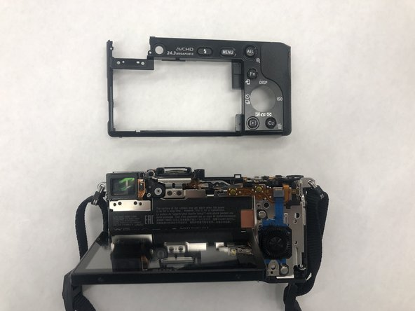Remove the back panel of the camera.