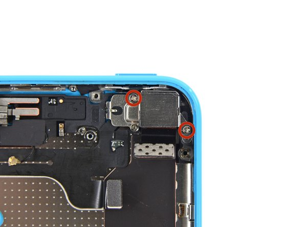 Remove the two 1.5 mm Phillips #000 screws securing the rear camera cover to the rear case.
