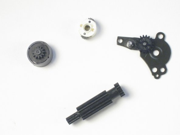 Removing the lens motor cover, you should be left with these four pieces.