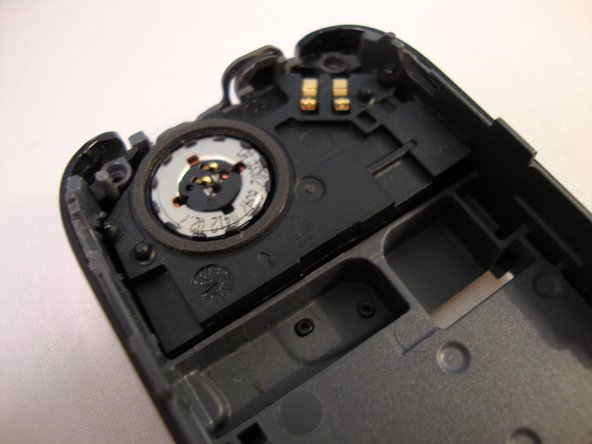 Lift the speaker out of the back housing of the phone.