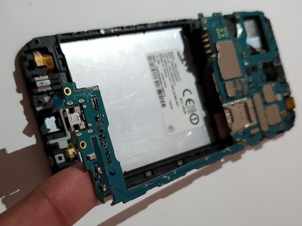 Carefully lift up the motherboard with your finger starting from the bottom up