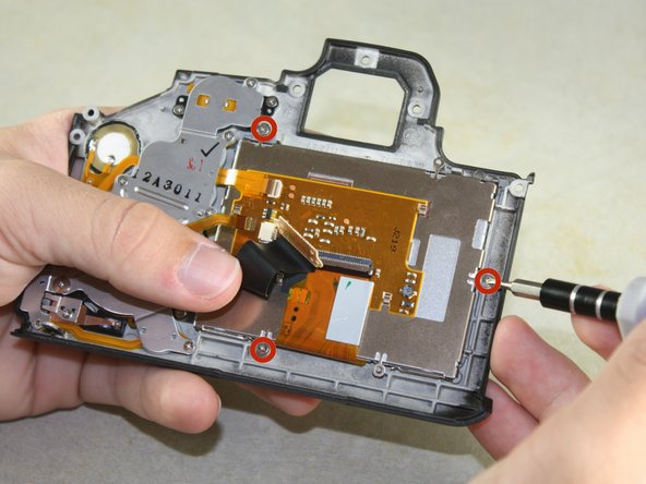 Remove three 3mm Phillips #00 screws from the inside of the panel.