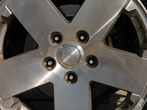 Take all 5 lug nuts off and remove the wheel by pulling it straight away from the vehicle.