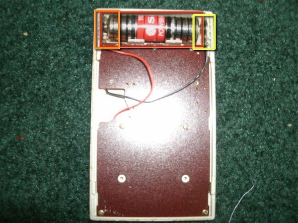 Now that we removed the back of the calculator, here is the battery and the back of the logic board.