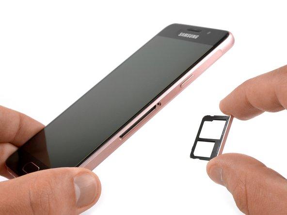 Remove the SIM card tray.
