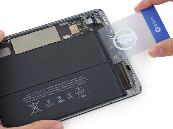 Throughout the following procedure, you'll be sliding thin plastic cards between the battery and rear case of the iPad to separate the adhesive securing the battery in place. Be careful to keep the cards as flat as possible to avoid bending the battery, which may damage it and cause it to release dangerous chemicals.