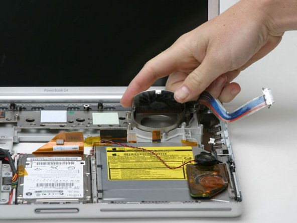 Lift the fan from the front, and pull it out of the computer.