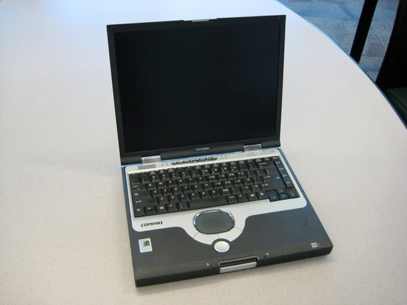 Turn the laptop top side up with the front facing forward. Open the screen.