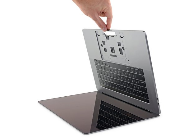 The liquid adhesive remover provided in your kit can damage the antireflective coating on your MacBook Pro's display, as well as the plastic keyboard keys.