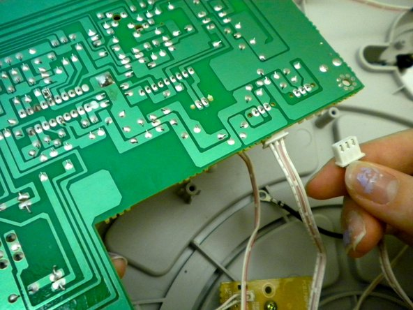Gently pull out the wires plugged into the circuit board.