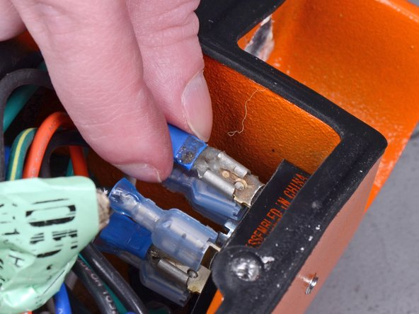 Remove the black wire's plug from the 4-pin rectifier.