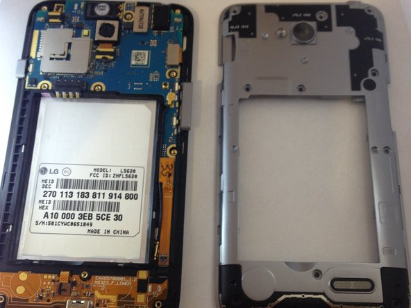 Using the plastic opening tool, carefully pry and separate the plastic midframe from the rest of the phone.