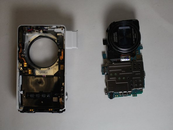 Lift the motherboard and lens out of the case.