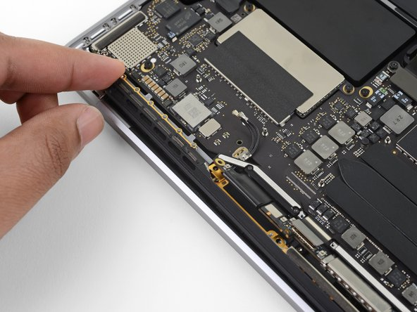 Carefully remove the antenna assembly, while simultaneously feeding the antenna cable bundle through the hole in the chassis.