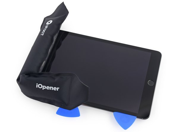 Reheat the iOpener and place it on the top edge of the iPad, over the front-facing camera.