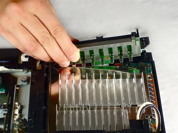 Gently lift the controller port board out of its recess within the bottom case.