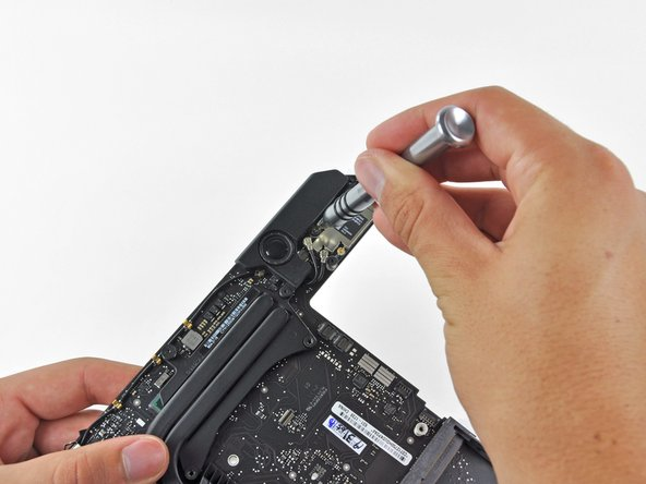 Two T6 Torx screws hold the speaker in its place on the logic board.