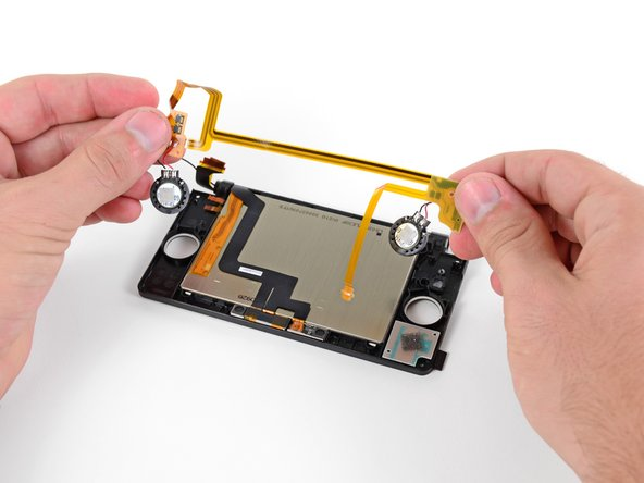 Remove the speaker assembly from the rest of the display assembly.