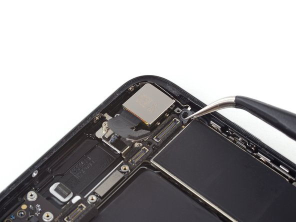 Use tweezers to gently bend the logic board grounding bracket out of the way.