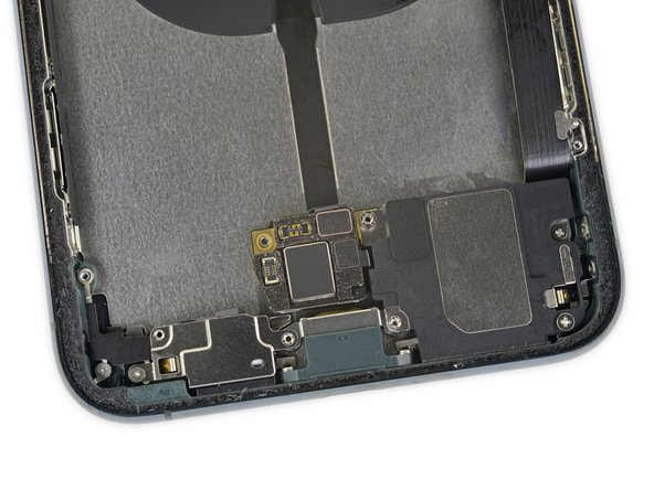 That mystery board that we spotted in the X-ray below the battery serves (in part anyway) as an interconnect for the battery, wireless charging coil, and Taptic Engine.