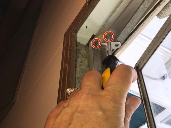 Using a Phillips screwdriver, remove the two screws from the mount at the opposite end of the bar.