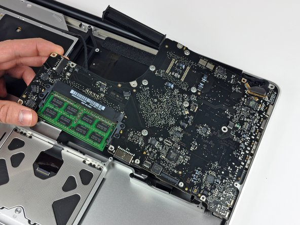 Carefully lift the logic board assembly from the left side and work it out of the upper case, minding the port side that may get caught during removal.