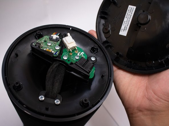 Remove the bottom shell from the speaker.