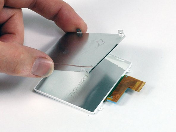 Lift the LCD metal backplate up and away from the display.