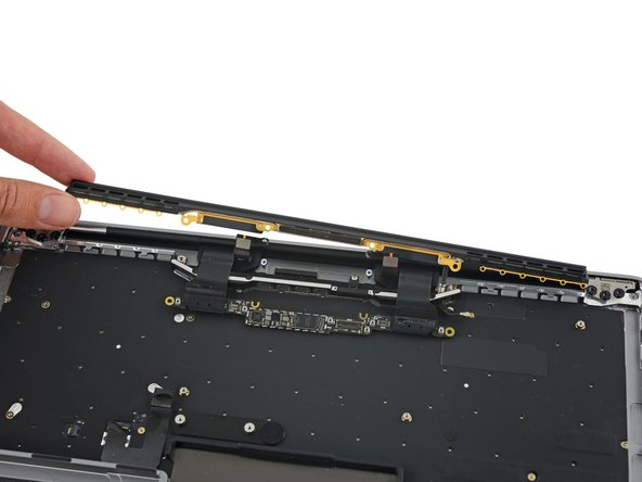 At MacBook's edge we come across a shiny bar (held in by 12 P2 Pentalobe screws) that also serves as an antenna.