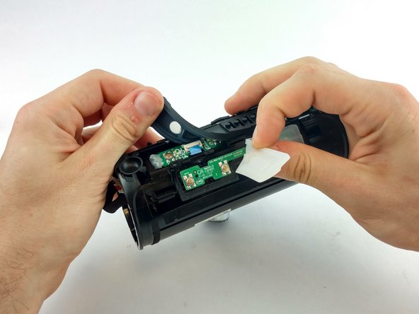 Remove silicone button covers by peeling back the silicone covering. This will expose the circuit board.