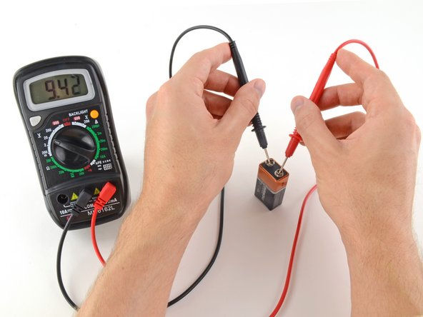 With the range set correctly, we get a reading of 9.42 volts.