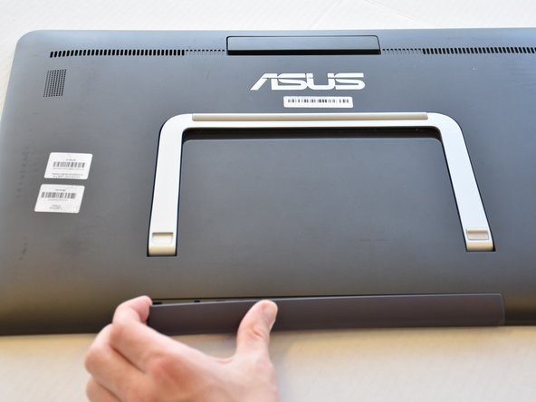 Remove the grey scuff guard at the bottom of the PC by pressing down on it, and pulling it away.