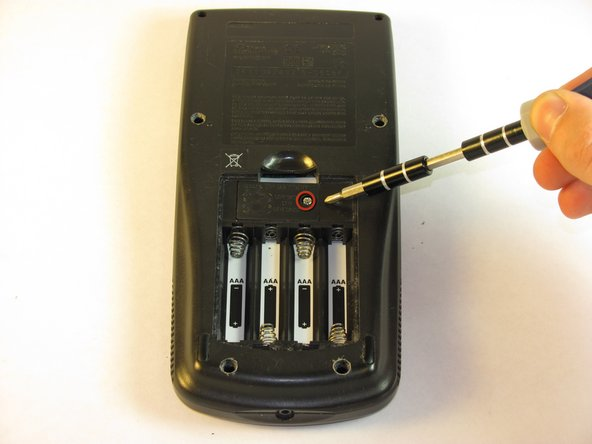 Remove the 5mm Philips #00 screw holding backup battery cover.