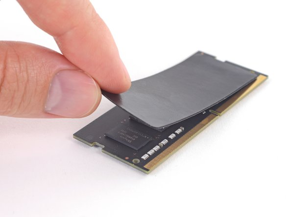 The original RAM module closer to the logic board has a thermal pad adhered to its top side (facing away from the logic board, between the two DIMMs).