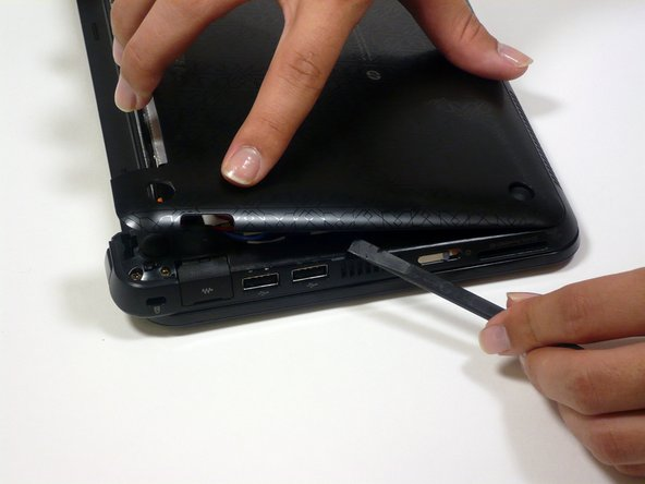 If the back case does not separate from the netbook easily, use the spudger to pry off the back case by the edge near the battery compartment, and work your way to the sides. The case will then pivot along the front edge.