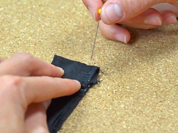 Pin the folded zipper webbing in place.