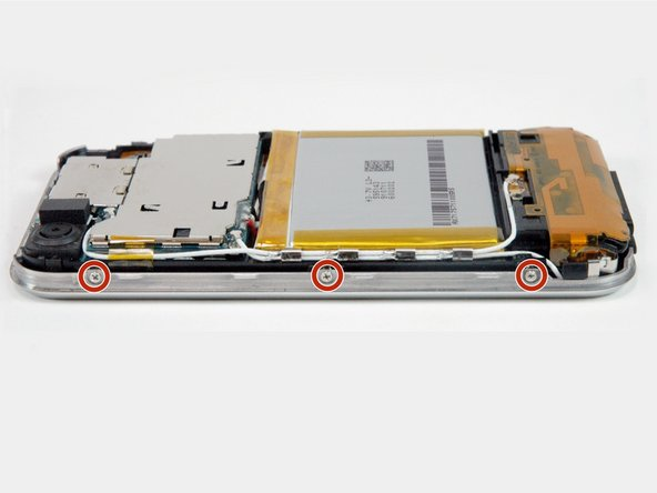 Rotate the iPhone 90 degrees and remove the three Phillips #00 screws from the side of the iPhone.