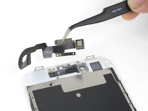 Remove the front camera and sensor cable.